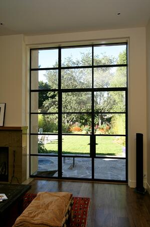 French door with muntins and mullions joining sidelite and transom lite